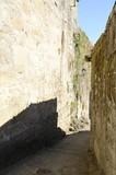 Narow stone alley in Tui, Galicia, Spain