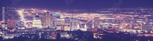 Fototapeta Vintage toned Salt Lake City downtown night panorama, Utah, USA.