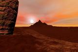 Mountain, a rocky landscape, orange horizon and clouds.