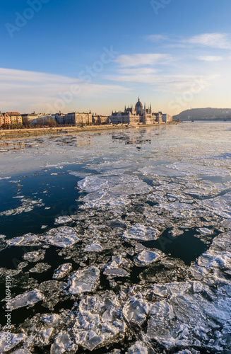 Beautiful winter view of the Danube river and Hungarian Parliament in a Sunny da