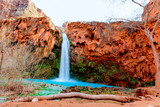 This is Havasu Falls on the Havasupai Reservation in Supai, Arizona. The falls have beautiful blue green flowing water, and this area is world famous.
