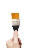 Male hand holding a flat tip paint brush, clipping paths included