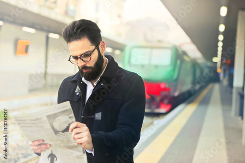 Commuter reading the newspaper Poster