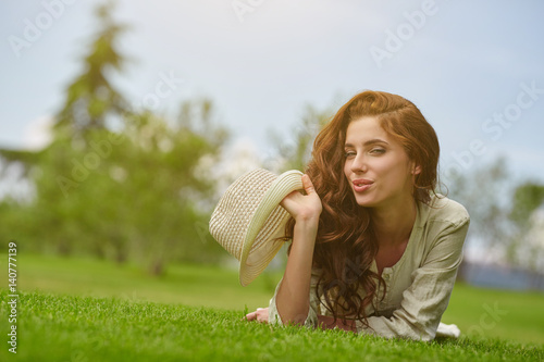 Pretty smiling girl relaxing outdoor