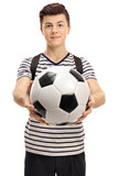 Teenage student with a football