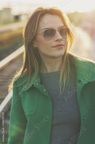 Amazing blond woman waiting for a train Poster