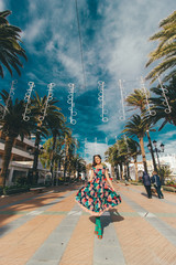 Girl in wonderful dress in Spain at the sea