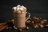 Hot chocolate with marshmallow on the wooden background. Shallow depth of field.