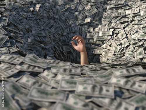hand drowning in money