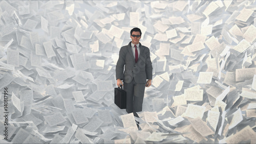 businessman in a paper storm
