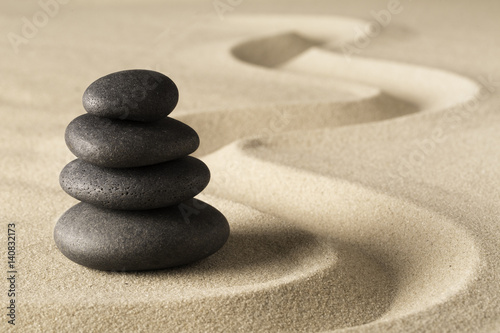 Fotobehang Stenen in het Zand Zen meditation stone and sand garden. Symbol for spirituality harmony and purity...