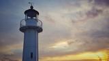 Beautiful sea sunrise. Lighthouse againt the sky.