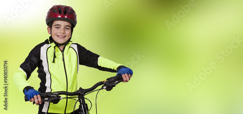 child with mountain biking, sports clothing and helmet
