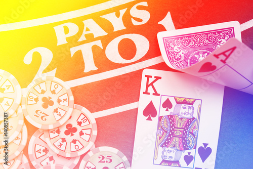 Poster Blackjack playing cards hand on colorful background with chips stack