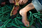 Close up of rock climber putting climbing shoes on
