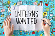 Постер, плакат: Interns Wanted text with hands