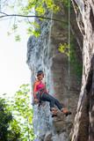 Woman rock climbing on Ontario's Niagara Escarpment in Canada