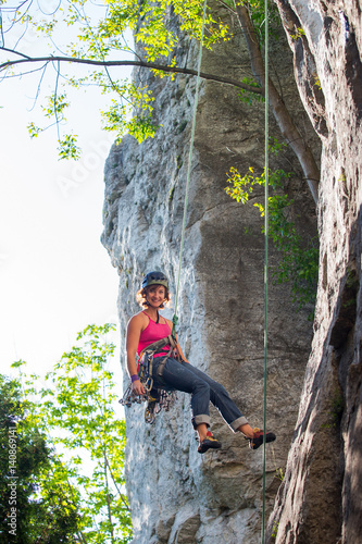Woman rock climbing on Ontario's Niagara Escarpment in Canada