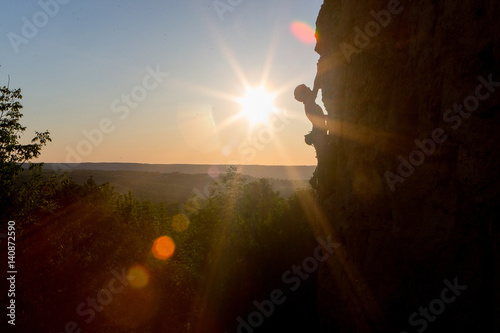 Poster Guilin Silhouette of a Woman rock climbing on Ontario's Niagara Escarpment in Canada