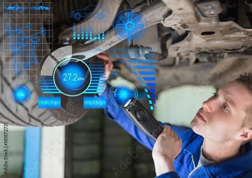 Attentive mechanic repairing hydraulic car