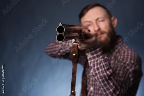 Man holding a shotgun Poster