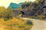 Stone arch over the road. Beautiful nature