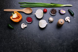 Fresh vegetables and spice on gray background, top view