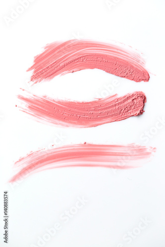 Texture of gently pink lipstick  isolated on white background Poster