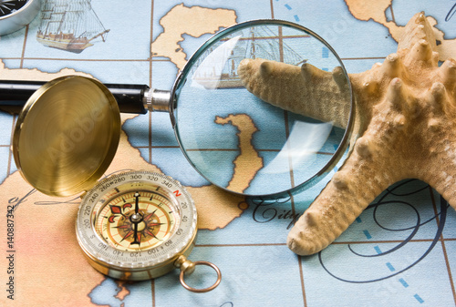 magnifier and compass on  map