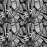 Black and white tropical pattern with exotic plants. Seamless vector tropical pattern with  leaves.