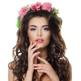 Fashion Beauty Portrait of Beautiful Woman with Makeup, Long Curly Hair and Flowers. Perfect Model with Spring Style Make up