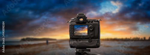 Foto op Canvas Europa DSLR camera on tripod shooting seascape sunset