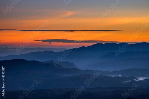 Poster Oranje eclat Clouds over the valley on early morning before sunrise from Sri Pada (Adam's Peak), Sri Lanka.