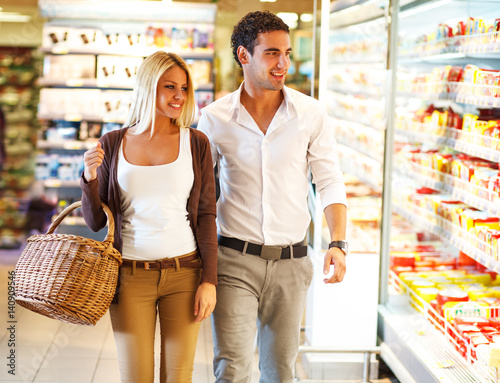 Young couple buying food at the supermarket.