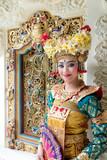 balinese legong dancer at decorative window