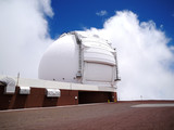 Telescope on the summit of Mauna Kea on the cloudy day