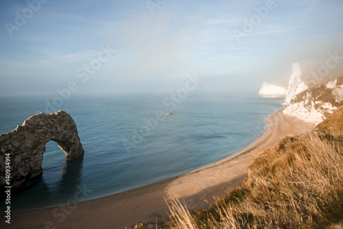 Poster Durdle Door is a natural limestone arch on the Jurassic Coast near Lulworth in D