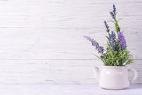 Lavender flowers in watering can, wooden background, copy space - 140952593