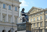 WARSAW, POLAND. A bronze monument to Nicolaus Copernicus against the background of historical buildings - 140956387
