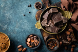 Dark chocolate pieces crushed and cocoa beans, culinary background, top view - 140972380