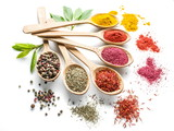 Assortment of colorful spices in the wooden spoons on the white background. - 141002156