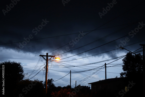 Poster Street light at night with a stormy sky background