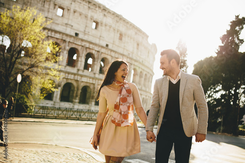 Loving couple in front of the Colosseum in Rome, Italy