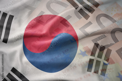 Poster colorful waving national flag of south korea on a euro money banknotes background