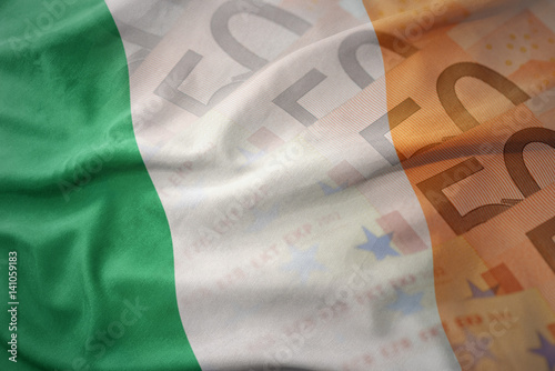 colorful waving national flag of ireland on a euro money banknotes background Poster