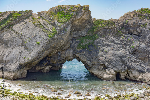 Poster Rock formation at Durdle Door & Lulworth Cove in Dorset, UK on a sunny summer's