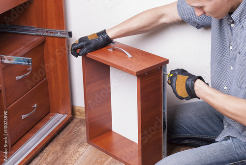 Plakat worker repairs furniture