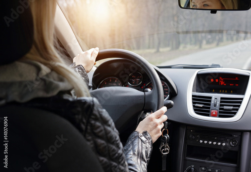 Woman enjoying car driving. Travel and freedom concept