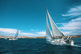 Luxury yachts at regatta. Sailing through the waves at the Aegean Sea. - 141088955