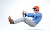 Man in red helmet and goggles car driver with steering wheel, auto concept - 141094343